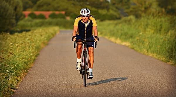 Racing cyclist alone on a country road